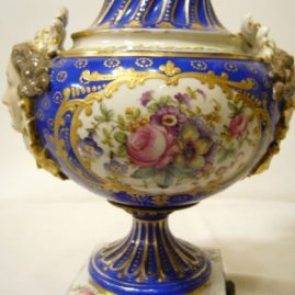 Lamp attributed to Sevres finely painted with flower bouquets and figural masked ladies on each side, jeweling and raised gilding, height of lamp without harp-16 inches, Price on Request