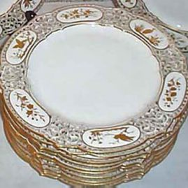 Set of twelve Sevres reticulated plates each hand gilded differently
