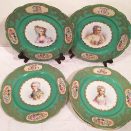Set of five Sevres portrait plates, each painted with different ladies of the court, artist signed Maglin, circa-1837, each with raised gold monograms of the famous ladies with raised gilding and cartouches of flowers around edge. Price on Request