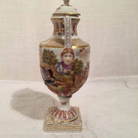 "Side of Capodimonte urn with raised detailed decoration, 10"", late 19th century, masked faces, $1200.00"