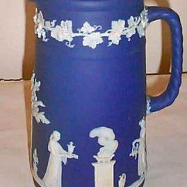 Tall Wedgwood dark blue jasperware pitcher, 1890-1920