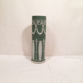 Tall green Wedgwood vase with lilies of the valley and rams heads