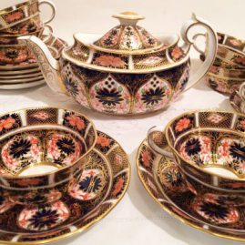 Beautiful Royal Crown Derby Imari teapot and eight matching cups and saucers, Circa-1904-1905. Sold.