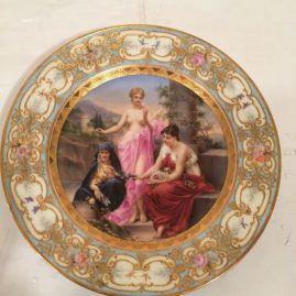 Royal Vienna plate depicting the three graces, with raised gilding and flowered border, late 19th century, 9 1/2 inches, Price on Request