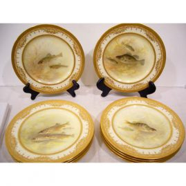 11 Royal Doulton fish plates made for Tiffany with raised gilding, each painted