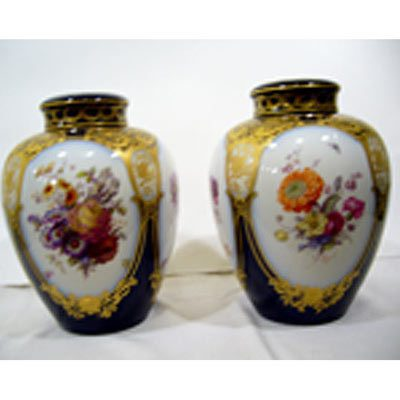 Other side of pair of KPM covered urns, with beautiful paintings of flowers, four bouquets on each vase