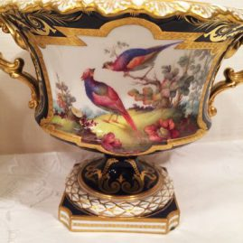 One of the pair of cobalt Royal Crown Derby urns or vases with handpainted bird decorations, artist signed Darlington, 10 inches wide by 6 inches tall, Price on Request