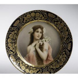 Royal Vienna cobalt plate of beautiful lady signed Wagner with raised gilding, entitled Unschuld, Diameter is 9 1/2 inches, Price on Request