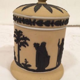 Wedgwood covered box in rare beige and black. Height is 5 inches. Sold