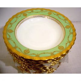 Set of 18 Doulton Burslem wide rim soups, all with bows and swags in raised gilding, 12 marked Doulton Burslem-ca-1899, and 6 marked Royal Doulton- circa-1903, all match perfectly,width 9 1/2 inches, Sold.