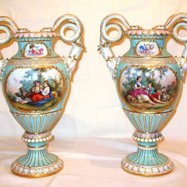 Pair of beautifully painted Meissen vases with Boucher scenes on   one side and flowers on the other side, ca-1880s-1890s. Sold