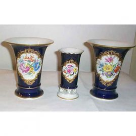 Meissen 3 piece garniture set, ca-mid 20th century. The small   vase is sold. The pair of vases are still available.