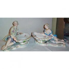 Pair of Meissen figural sweetmeat bowls with raised flowers, circa 1870s, price on request