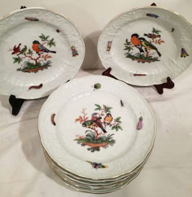 Meissen plates each painted differently with birds and bugs