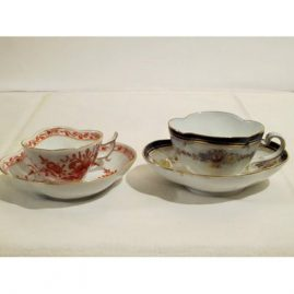 Two rare quadrefoil shaped Meissen cups and saucers. Both late 19th century. Sold