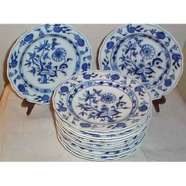 Nine Meissen blue onion  dinners. Price on Request