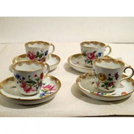 Four Meissen demitasse cups and saucers with different bouquets of flowers on each one