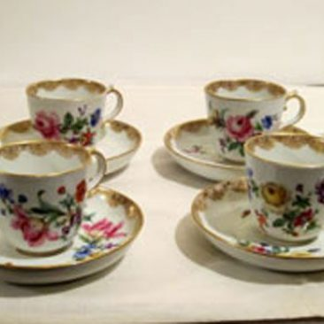 Four Meissen demitasse cups and saucers with different bouquets of flowers on each one. The bouquets on each cup match the bouquets on the saucers. Late 19th century. Sold