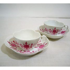 Two rare Meissen quatrefoil shape cups and saucers