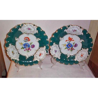 Pair of green Meissen chargers with flowers