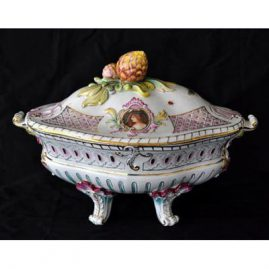 Rare Meissen tureen with raised feet and two different portrait medallions. Late 19th century. 14 inches long by 9 1/2 inches wide. Cancellation Marks. Price on Request