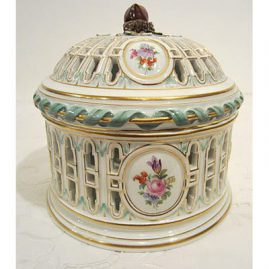 Meissen rare reticulated covered basket painted with cartouches of flowers, circa-1880s, 7 1/2 inches tall and 8 inch diameter. Sold.