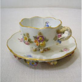 Rare Meissen cup and saucer, with raised flowers on all sides and on the bottom of the saucer. Cup and saucer each have six raised feet, Sold.