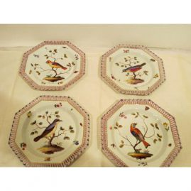 Four Meissen reticulated octagonal plates with bird and bug decoration