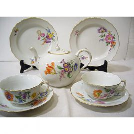 Meissen tea set with large bouquets of  flowers, each piece painted differently, teapot with flower on top, 7 cups and saucers, 12 dessert plates, Sold. We have other flowered Meissen tea sets available.