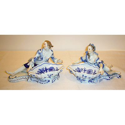 Pair of Meissen figural salts with raised flowers on bowls