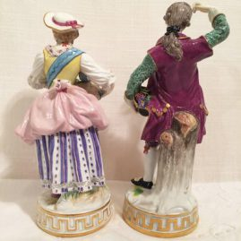 Back of the  pair of Meissen figures of  a lady and gentleman with flowers, Man is 6 3/4 inches tall and lady is 6 1/2 inches tall, Circa 1880s, Price on Request.