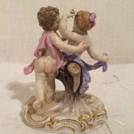 Back of Meissen figurine of boy and girl putti dancing with flowers. Circa 1880s, Height-5 inches tall by 4 1/4 inches wide. Price on Request