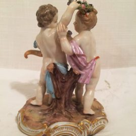 Back of  Meissen boy and girl putti with flower wreath and cornocopia, Circa-1880s, 5 inches tall by 4 inches wide. Price on Request