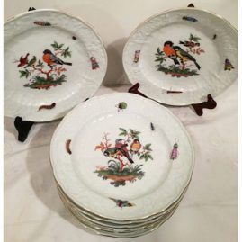 Set of nine Meissen plates each painted with different birds and bugs with white raised repousse design