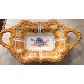 Two handled Meissen gilded charger with a blue flower and raised gold leaves and flowers decoration. Circa-1923-1933, 13 3/4 inches wide by 8 1/4 inches tall. Sold.