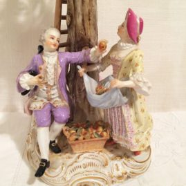 Close up of large Meissen figural group of four Meissen apple pickers