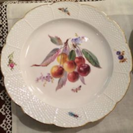 Close-up of one of the set of twelve Meissen fruit plates seen in previous picture. Circa-1880s, You can see the closed lace work and the beautiful fruit painting. Each plate is painted differently .Diameter-8 3/8 inches. Sold