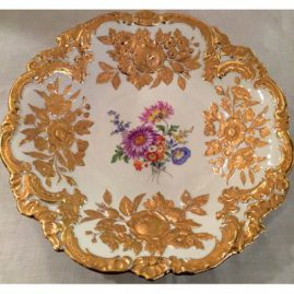 Large round Meissen gilded charger with flower bouquet decoration, and raised gold flowers accenting the charger. 12 inch diameter. Price on Request