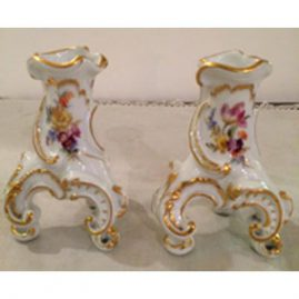 Pair of Meissen candlesticks or vases on three feet. late 19th century. Height-3 1/2 inches. Sold.