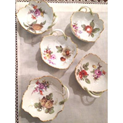 Five Meissen lead dishes painted with different fruits and flowers.