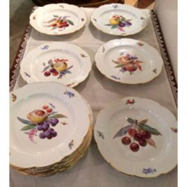 Set of twelve Meissen fruit plates, each painted with different fruits and bugs , circa-1880s, 8 3/8 inches diameter, with lace work on the border. Sold.