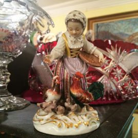 Meissen figurine of a lady feeding the chickens