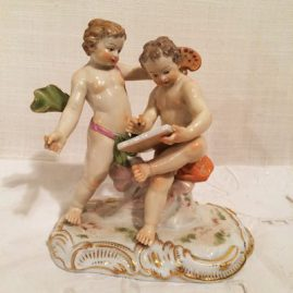 Meissen figural group of artists, one putti having an artists  pallette in his hand with a brush and the other putti drawing an etching of a figure, circa-1880s, 5 inches tall by 4 1/2 inches wide, Price on Request.