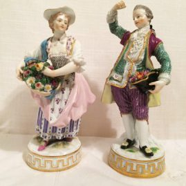 Pair of Meissen figures of  a lady and gentleman with flowers, Man is 6 3/4 inches tall and lady is 6 1/2 inches tall, Circa 1880s, Price on Request.