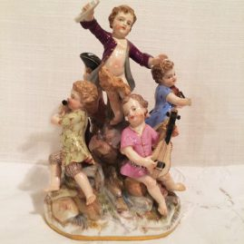 Meissen figural group with five Meissen musicians, one conducting, one playing the violin, one playing the cello, one playing the flute and one playing the mandolin, Circa-1880s, Height- 6 1/2 inches by 5 1/2 inches. Sold
