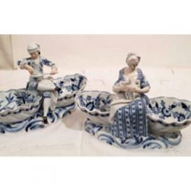 Pair of rare blue onion Meissen Sweetmeat dishes with boy eating soup and lady with a chicken