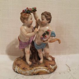 Meissen boy and girl putti with flowers and cornocopia, Circa-1880s, 5 inches tall by 4 inches wide. Price on Request
