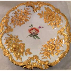 Large round Meissen gilded charger with painting of orange flower and raised gold flower decoration. Circa-1923-1933  Diameter-12 inches. Price on Request