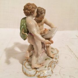 Side of Meissen figural group of artists