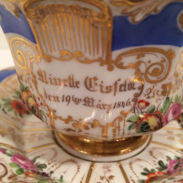 Close up of oversized German hand painted cup and saucer, dated 1896, Sold.